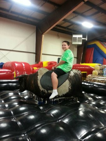 Playland Adventures: The boy riding the bull