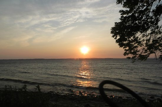 Marine Village Cottages: Sunrise over Lake Champlain, view from the porch of our cabin.