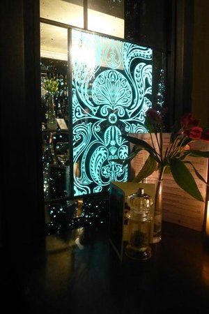 The Cornstore : Decorative mirror in booth adjacent to the bar