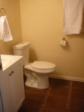 Holly, CO: comfortable all tilled bathroom with open space shower