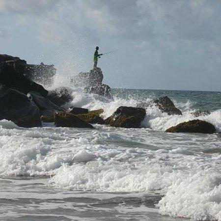 Petite Anse Beachfront Hotel & Restaurant Grenada: Fisherman from the edge of the Petite Anse Beach
