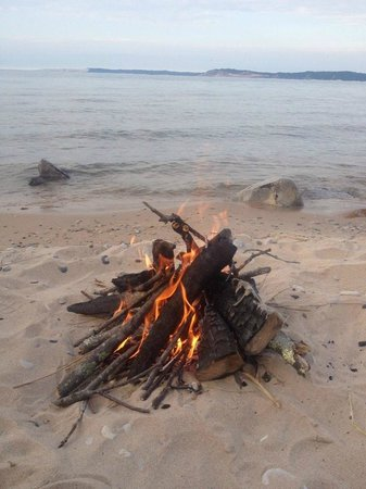 Platte River Campground: Our bonfire while watching a sunset on the beach.