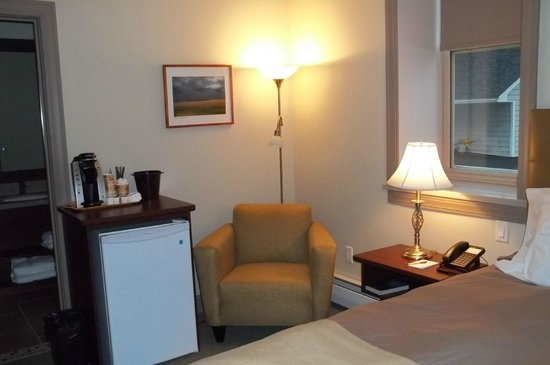 Inn of Acadia: chair, frig and coffee maker in room