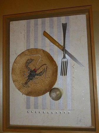 Auberge Napoleon restaurant: An example of the neat artwork inside the restaurant