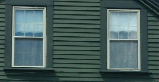 Fall River, Массачусетс: Looks like a woman in a victorian dress in the upstairs right-hand window. I didn't notice it un