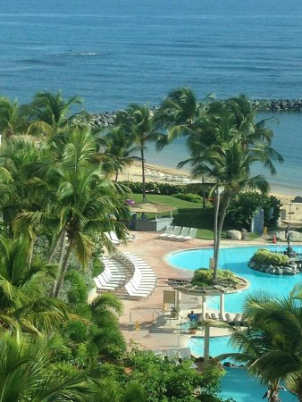 Embassy Suites by Hilton Dorado del Mar Beach Resort: View from the hotel out to the pool