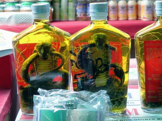 Tachileik Market : Snake and Scorpion whisky for sale in Tachileik