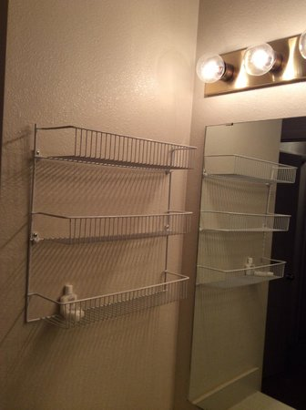 Snow King Resort : Note the dated fixtures and wire basket shelving in bath.  Very skimpy on amenities!