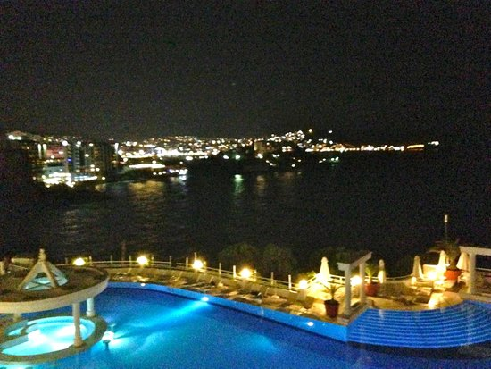 Korumar Hotel De Luxe : Balcony view across pool to Kusadasi