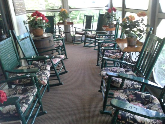Big Moose Inn, Cabins & Campground: Front porch bedecked with rockers