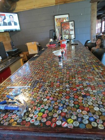Blue Levee: The Bottle Cap Topped Bar Counter