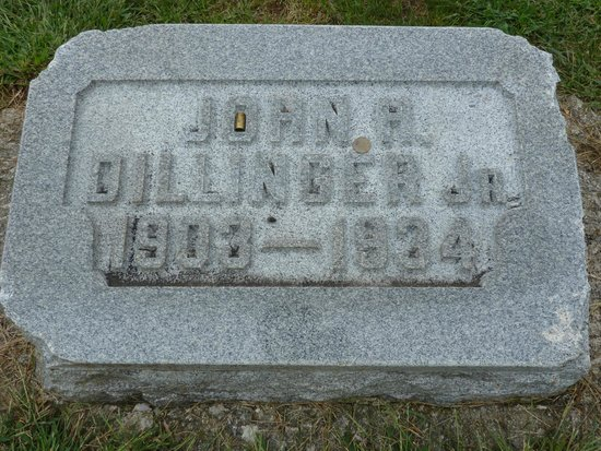 Crown Hill Cemetery: John Dillinger's headstone.  Notice the bullet shell in the