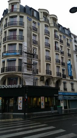 Hotel building with McDonalds - Picture of Hipotel Paris Printania ...