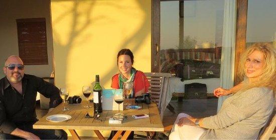 Wild Clover Farm: Enjoying sundowners on the cottage veranda with Dax Villanueva (Relax-With-Dax blog), Lauren McC