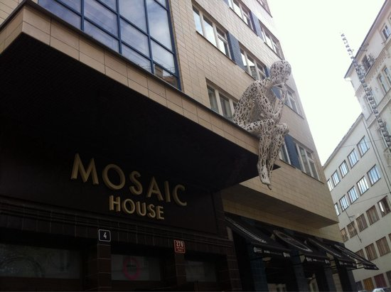 Mosaic House: The thinking man greets you into the hostel.