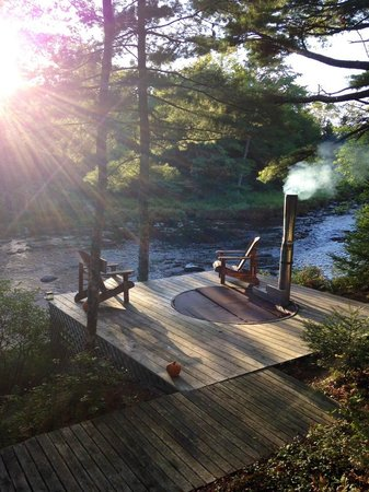 Trout Point Lodge of Nova Scotia: Wood burning hot tub by the river
