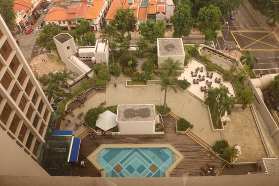 Village Hotel Bugis by Far East Hospitality: View from our room window to the pool area