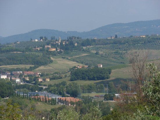 Castello di Montegufoni : View of wine factory and neighboring village