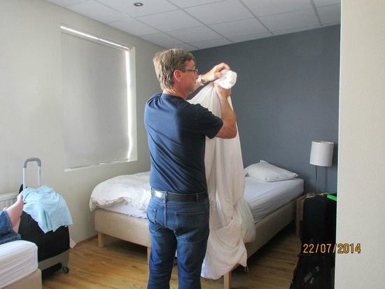 Reykjavik Downtown Hostel: Two twin beds together and our duvets with covers