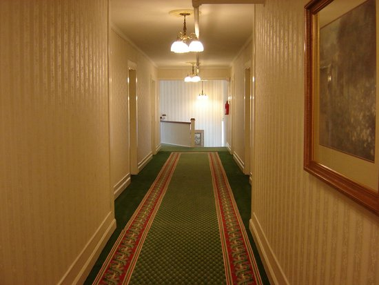 The Green Park Inn: long hall to room 301. Floor is uneven with soft places.