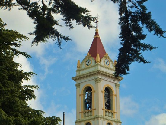 Catedral Sagrado Corazon: The Bell Towers ring reverberates through the town.