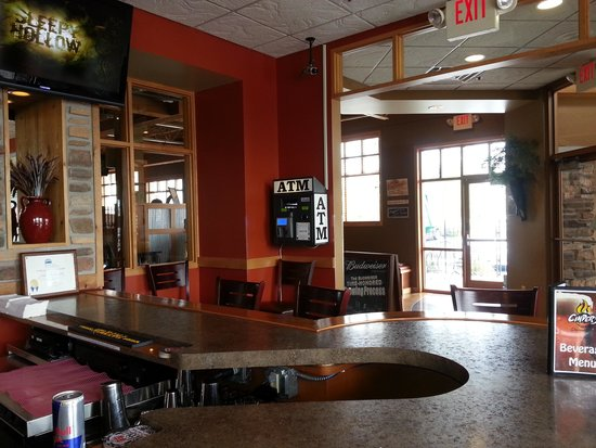 Cinder's Charcoal Grill: entry from bar area