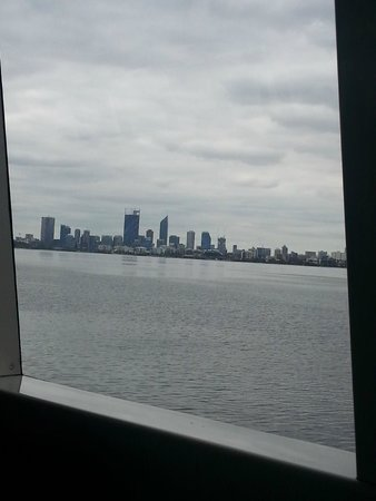 Captain Cook Cruises: It was so still and calm that you could see the reflection of the buildings in the water