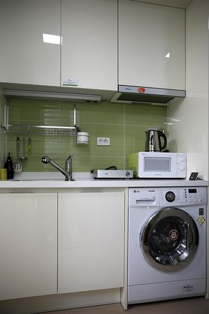 kitchen design with washing machine. Ever8 Serviced Residence  Small Kitchen And Huge Washing Machine Dryer For A Comfortable Stay