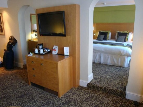 Holiday Inn Kenilworth - Warwick: Hairdryer fixed in drawer with TV above