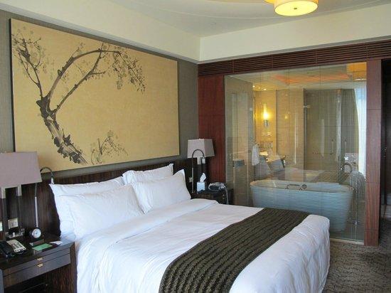 Regent Beijing : Bed and Bathroom with picture window.