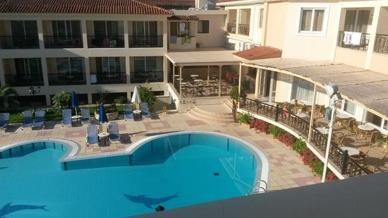 Petros Hotel: The view from one side of the balcony , the park hotel next door