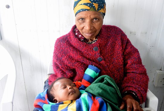Uthando Tours: A grandmother caring for her grandchild at a senior center.