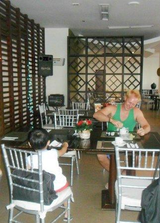 Summit Circle Cebu: Dining Area - hubby having his welcome coffee