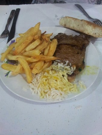 Toubkal Snack: Steak and french fries with rice