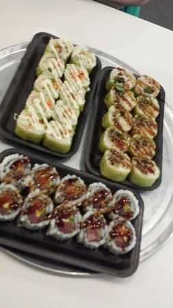 Rollbotto Sushi: Chicken Teriyaki roll, Surf and Turf roll,  and custom tuna and salmon roll
