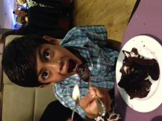 Indigo Restaurant: Had to have a dessert even though he was full!!