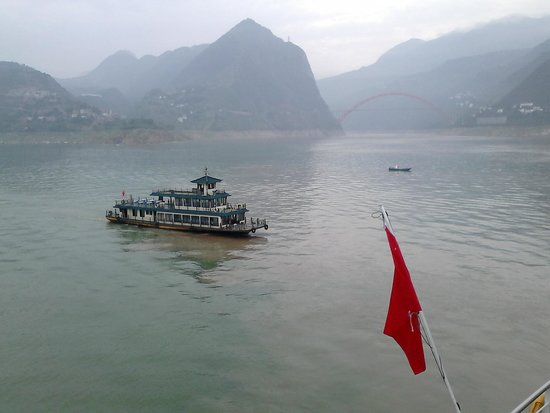 Small Three Gorges in Chongqing : Tourist boat approaching the Viking Emerald at entrance to Daning River prior to transfer for tr