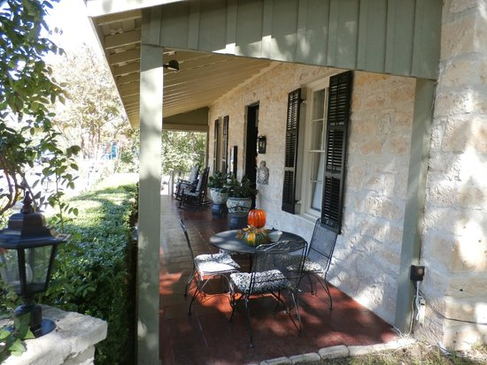 Inn on the Creek: Charming covered porch with rockers and seasonal decor welcomes you!