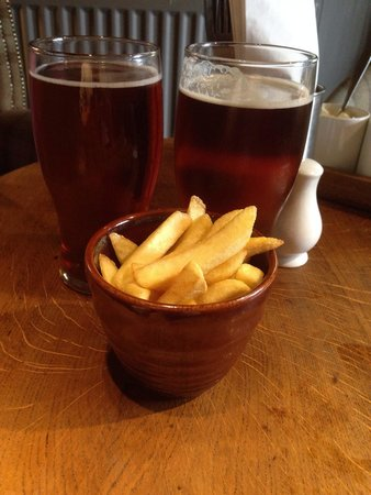 Dun Cow: Should have gone to the green man! Shan't be back. £9.50 for a shandy, a pint and 23 cheap chips