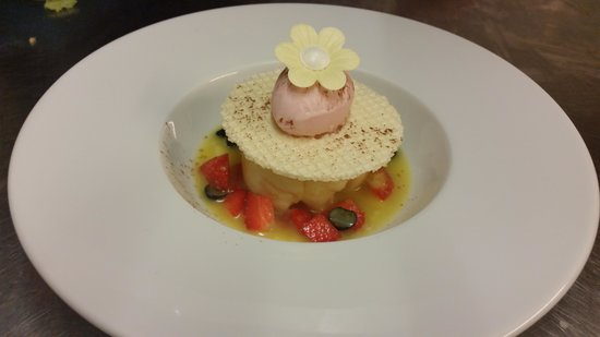 The Ruperra: pineapple ravioli, sweet black olive, coconut and raspberry filling with mango and pineapple bro