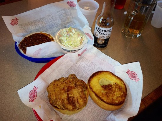 Fuddruckers : Crispy chicken sandwich with side of baked beans and slaw.