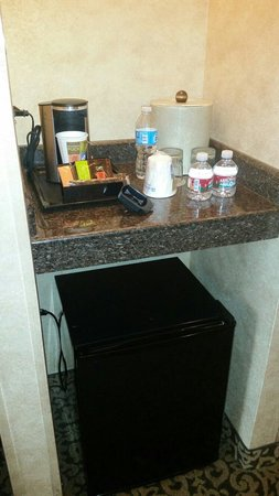 "Wyndham Anaheim Garden Grove: Mini fridge and coffee maker in the ""Family Room""."