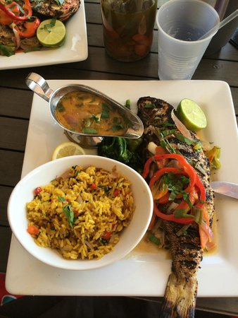 Sunset Grille - Secret Harbour Resort: Yellow tail Red Snapper with Seasoned Rice