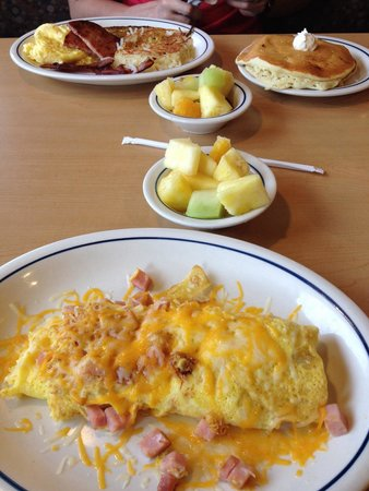 IHOP : Omelette, pancakes, hash browns, bacon, ham, sausage, fruita