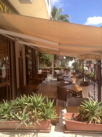 The Plum Tree Bar & Restaurant: Our front outdoor seating. 4x4 & 6x2 tables.
