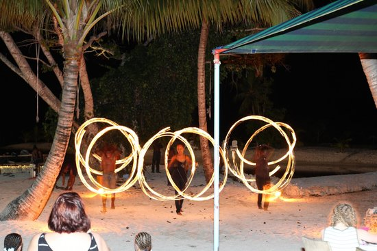 Aquana Beach Resort: Fire Dancers - one of the many activities at night for guests