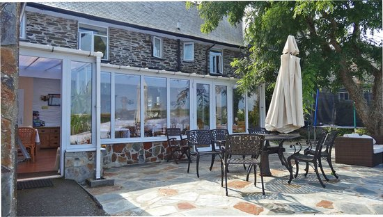 The Old Coach House : The patio and conservatory