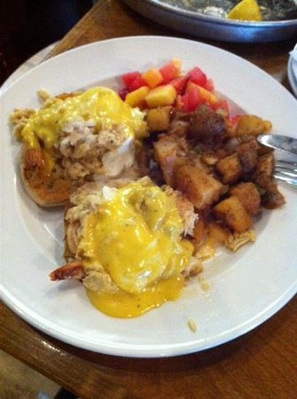Capt. Groovy's Grill and Raw Bar: Shrimp and Lump Crab Eggs Benedict Over Toasted Muffins with Cajun Hash Browns and Fruit Salad