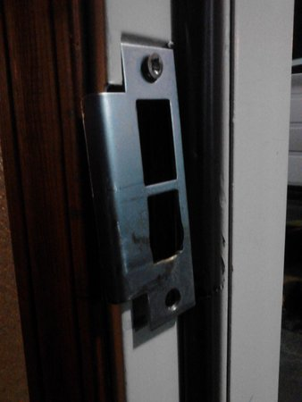Motel 6 Portland Downtown: room #114; broken door latch was never repaired upon request!