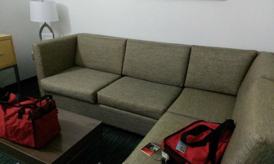 Holiday Inn Express Hotel & Suites San Antonio Rivercenter Area: Living room area with sofa couch.